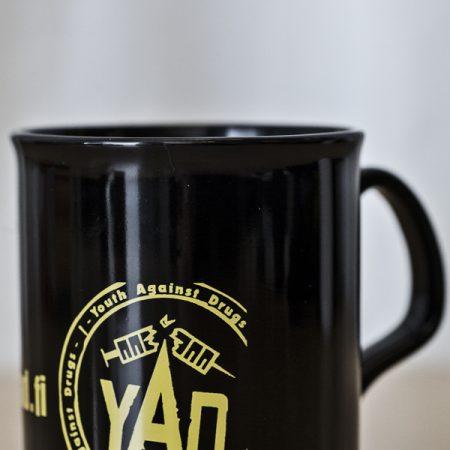 Muki - YAD:n logolla